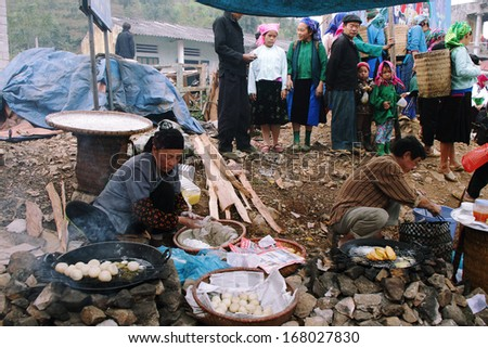HA GIANG, VIETNAM  - DECEMBER 7, 2011: Unidentified people of diferent ethnic groups in Lung Phin market. Lung Phin market is one of the most typical hill tribe markets in Vietnam.