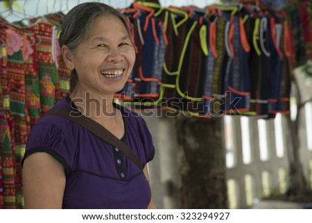 Ha Giang, Vietnam - September 16, 2015: Vietnamese, Mother souvenir trade Smiling greetings tourists in the rural villages of the province of Ha Sang.  north of Vietnam.