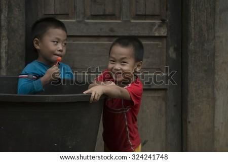 Ha giang, Vietnam - September 18, 2015: Vietnamese,When children receive candy Sweets and joking and smiling greeting visitors. province of Ha Sang.  north of Vietnam.