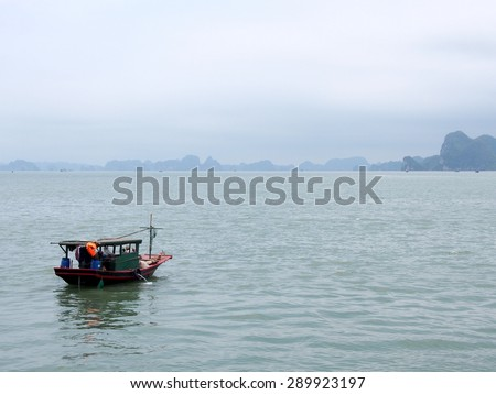 HA LONG BAY, VIETNAM - MAY 24: A local boat at Ha Long Bay, Vietnam on May 24, 2015. Ha Long Bay is a UNESCO World Heritage Site, and a popular travel destination, in Vietnam.