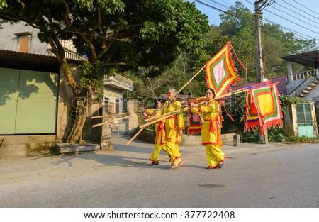 HA NAM, VIETNAM, Feb 14, 2016: people wearing traditional costumes at the festival on the occasion of the Lunar New Year. everyone hold a ceremony down the field.