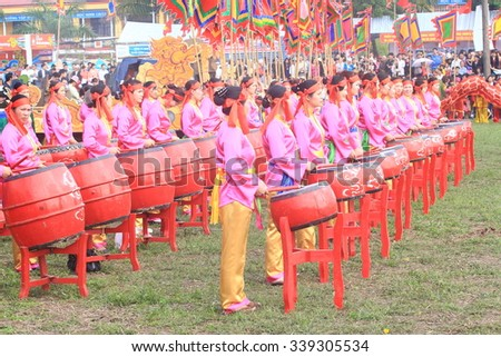 HA NAM, VIETNAM, February 25, 2015: unidentified group of people playing drums at the festival on the occasion of the Lunar New Year. This is a traditional festival of farmers in Vietnam.
