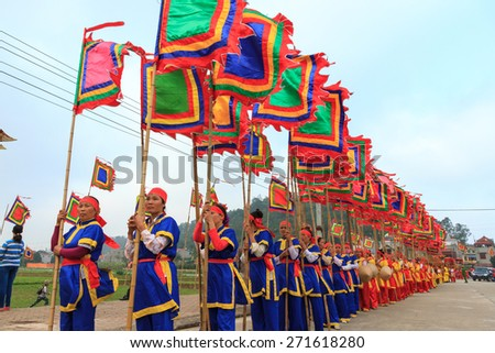 HA NAM, VIETNAM, February 25, 2015:unidentified group of people wearing traditional costumes at the festival on the occasion of the Lunar New Year .This is traditional festival of farmers in Vietnam.
