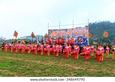 HA NAM, VIETNAM, February 25, 2015: unidentified people wearing traditional costumes at the festival on the occasion of the Lunar New Year. This is a traditional festival of farmers in Vietnam.