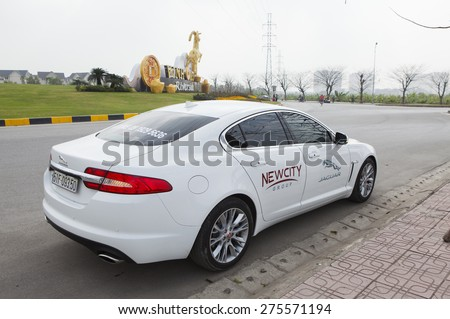 Ha Noi, Viet Nam - Jan 24, 2015: Jaguar XF car running on the road test in Vietnam - stock photo