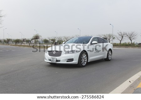 Ha Noi, Viet Nam - Jan 24, 2015: Jaguar XJ car running on the road test in Vietnam - stock photo