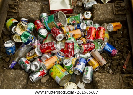 Ha Noi, Viet Nam - March 15, 2015: Used crushed beverage cans gathered in a pile for recycling include popular brands like coca cola, heineken, pepsi.