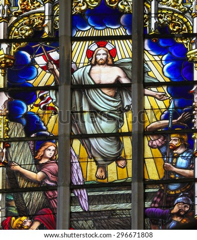 HAACHT, BELGIUM - MAY 30, 2015: Stained Glass depicting Jesus rising from the grave at Easter in the Church of Haacht, Belgium. - stock photo