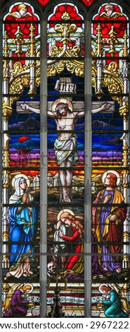 HAACHT, BELGIUM - MAY 30, 2015: Stained Glass depicting the Crucifixion of Jesus Christ in the Church of Haacht, Belgium. - stock photo