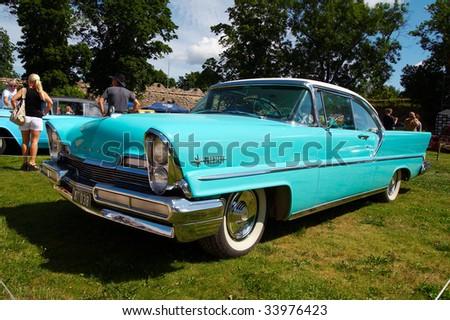HAAPSALU, ESTONIA - JULY 18: American Beauty Car Show, showing blue 1957 Lincoln Premiere Coupe 2D HT, front view on July 18, 2009 in Haapsalu, Estonia - stock photo