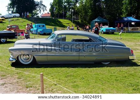 HAAPSALU, ESTONIA - JULY 18: American Beauty Car Show, showing grey 1952 Buick Super, side view on July 18, 2009 in Haapsalu, Estonia - stock photo