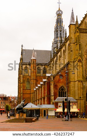HAARLEM, NETHERLANDS - JUN 2, 2015: Grote Kerk (Great Church) on the Grote Markt, Haarlem's central square in Haarlem, Netherlands. Haarlem is the capital of the province of North Holland