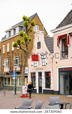 HAARLEM, NETHERLANDS - JUN 2, 2015: Typical houses in Haarlem, Netherlands. Haarlem is the capital of the province of North Holland