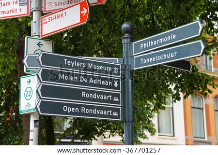 Haarlem, the Netherlands - June 20, 2015: Tourist signpost at the crossroads in the city centre. Haarlem is the capital of the province of North Holland and popular tourist place
