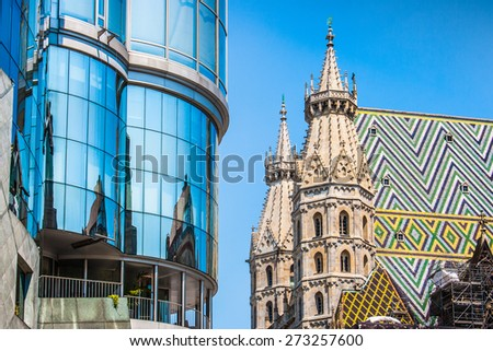 Haas Haus with St. Stephen's Cathedral (Wiener Stephansdom) at Stephansplatz in Vienna, Austria - stock photo