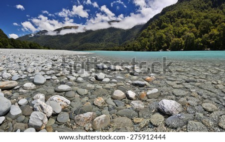 Haast River near Roaring Billy Falls (Mount Aspiring National Park, New Zealand) - stock photo