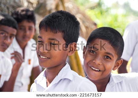 HABARADUWA, SRI LANKA - MARCH 11, 2014: Portrait of school kids at Sea Turtle Farm and Hatchery. The center was started in 1986 and up to now they released more than 500,000 Turtles to ocean