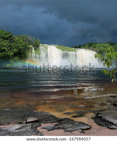 Hacha waterfall in the lagoon of Canaima national park before the storm - Venezuela