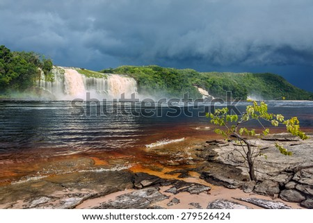 Hacha waterfall in the lagoon of the Canaima national park before the storm - Venezuela, Latin America  - stock photo