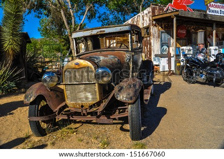 HACKBERRY, AZ - MAY 15: A vintage car left abandoned near the Hackberry General Store on May 15, 2013. Hackberry General Store is famous stop on the historic Route 66 - stock photo