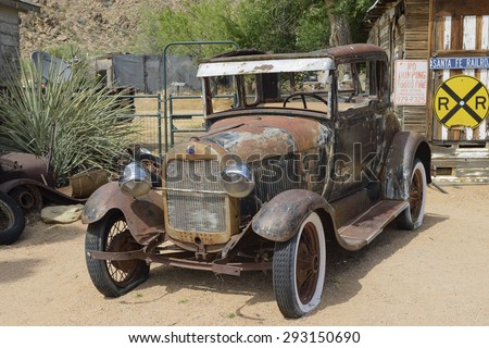 HACKBERRY, AZ - MAY 28: Rusty old-timer car at General Store at Hackberry, Route 66, on May 28, 2015, in Hackberry, Arizona, USA. The historic Route 66 is attracting visitors from all of the world. - stock photo