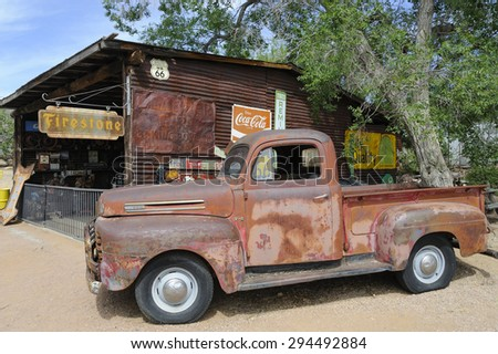 HACKBERRY, AZ, USA -MAY 28: Rusty old-timer pick-up car at General Store at Hackberry, Route 66, on May 28, 2015, in Hackberry, USA. The historic Route 66 is attracting visitors from all of the world. - stock photo