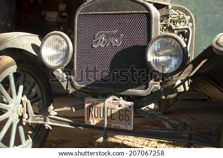 HACKBERRY, USA - SEPTEMBER 25: front of a old rusty Ford car with a Route 66 license plate, Hackberry, Arizona, United States of America, sept 25 2011 - stock photo