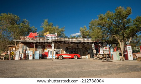 HACKBERRY, USA - SEPTEMBER 25, 2011: historic red Chevrolet Corvette at Hackberry General Store on Route 66, Hackberry, Arizona, United States of America, sept 25 2011 - stock photo