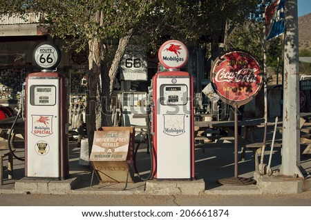 HACKBERRY, USA - SEPTEMBER 25, 2011: two old gas pumps at a historic gas station at Route 66, Hackberry, Arizona, United States of America, sept 25 2011 - stock photo