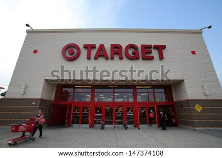 HACKENSACK - JULY 11: Shoppers walk past a Target department store in Hackensack, New Jersey on Thursday, July 11, 2013.  The Target Corporation is an American retailing company,  - stock photo