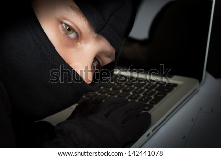 Hacker at work - stock photo