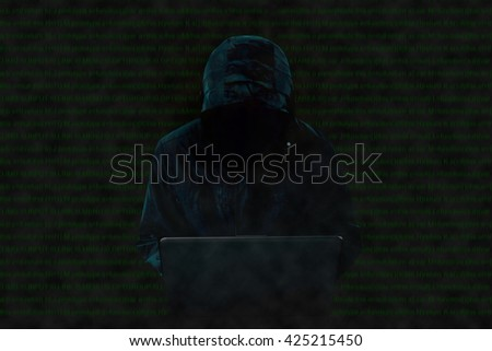 Hacker at work. - stock photo