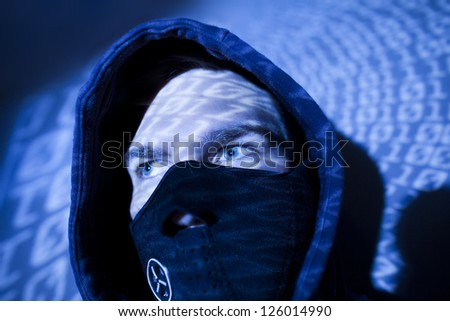 hacker blue colored  with binary background - stock photo