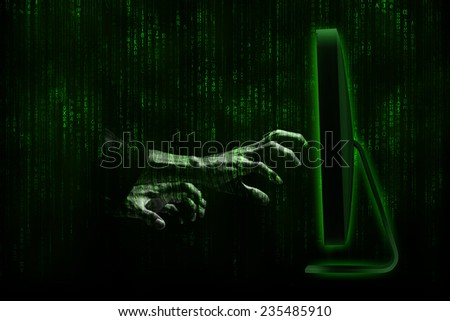 hacker hands with binary codes on monitor  - stock photo