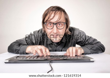 Hacker in Action on the keyboard - stock photo
