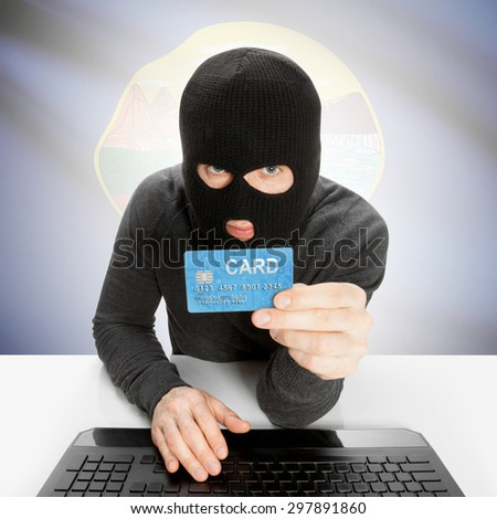 Hacker in black mask with USA state flag - Montana