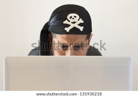 hacker  looking confused on white background - stock photo