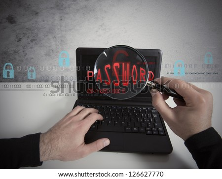 Hacker looking for a password in a laptop with lens - stock photo