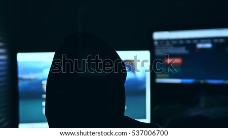 hacker man, trying to breach security of a computer system search internet