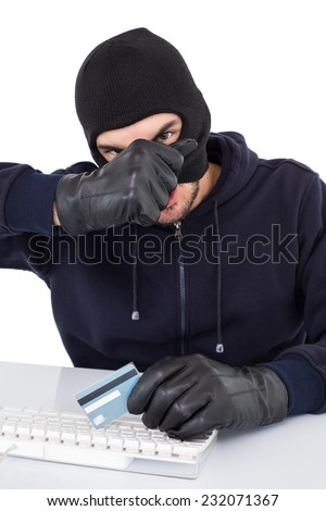 Hacker removing his balaclava to show his face on white background