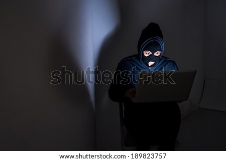 Hacker stealing data from the laptop