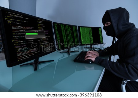 Hacker Stealing Data On Multiple Computers And Laptop - stock photo