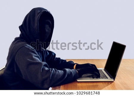 Hacker using laptop hacks network on a mesh light background, Payments system hacking concept