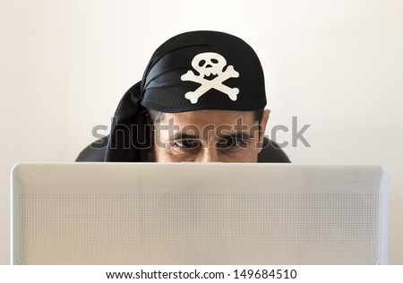 hacker watching and smilingon white background - stock photo