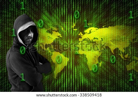 Hacker wearing a hood over a binary code and a globe - stock photo