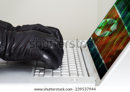 Hacker wearing black gloves using a laptop with North Korea flag in the background - stock photo