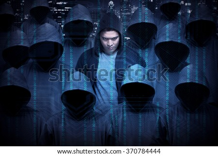 Hacker wearing hoodie shirt. Security concept image - stock photo
