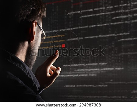 hacker with graphic user interface around - stock photo
