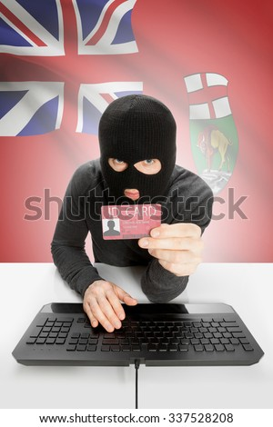 Hacker with ID card in hand and Canadian province flag on background - Manitoba - stock photo