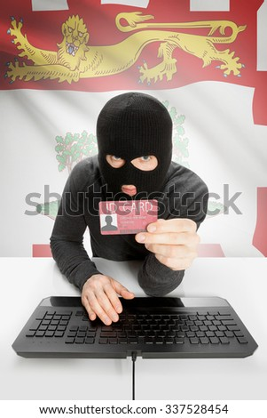 Hacker with ID card in hand and Canadian province flag on background - Prince Edward Island - stock photo